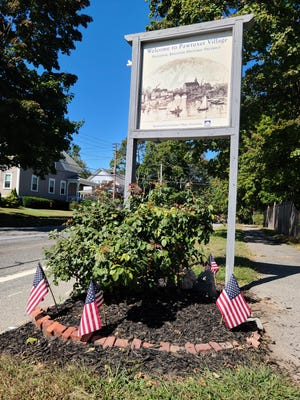 A sign on Narragansett Parkway in Warwick welcomes visitors to Pawtuxet Village.