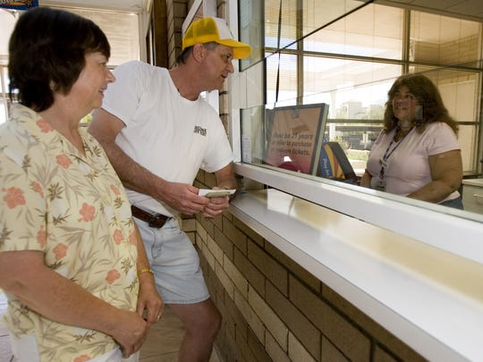 Diane and Kerry Carmichael buy lottery tickets at the
