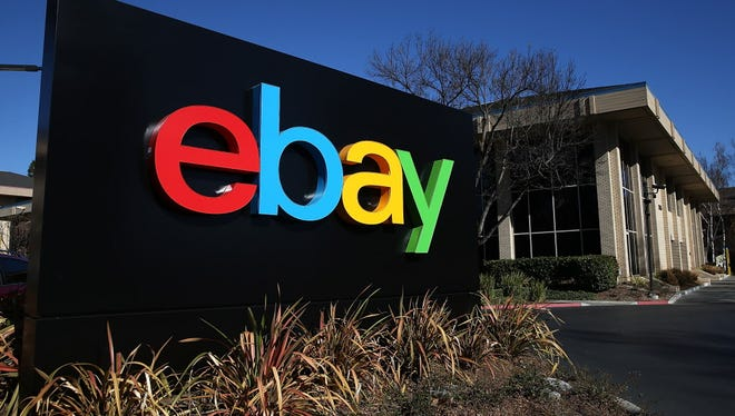 FILE - JANUARY 21, 2015: It was reported that eBay said it will cut 7 percent of its workforce, or 2,400 jobs January 21, 2015. SAN JOSE, CA - JANUARY 22:  A sign is posted in front of the eBay headquarters on January 22, 2014 in San Jose, California. eBay Inc. will report fourth quarter earnings today after the closing bell. (Photo by Justin Sullivan/Getty Images) ORG XMIT: 464899513 ORIG FILE ID: 464399567