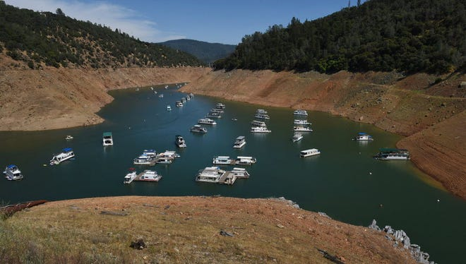Houseboats crowd each other in a severely depleted lake in California, one of the states hardest hit by the current western drought.