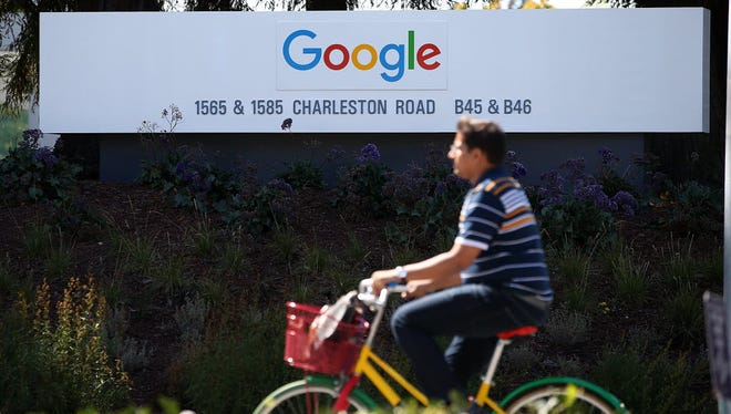 Google headquarters in Mountain View, Cali. Google parent Alphabet's 49% stock surge in 2015 has brought its market valuation closer to Apple's.