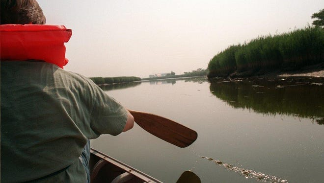 An individual paddles up Berry's Creek in the summer of 1997. .