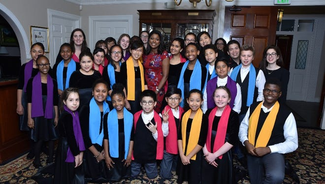 ABC News anchorwoman Lori Stokes, center, with members of the Youth Chorus from The Thurnauer School of Music in Tenafly