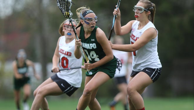 The speedy Taylor Pani (center) helped Ramapo win the Independent North title.