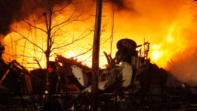 Continental Airlines Flight 3407, operated by Manassas, Va.-based Colgan Air, burns Feb. 12, 2009, after it crashed into a house in Clarence Center, N.Y.