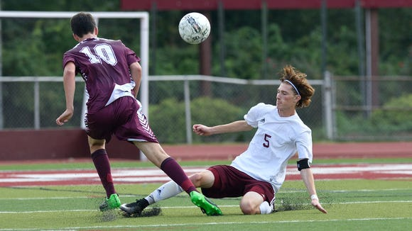 Ridgewood's Davis Weil (10) and Wayne Hills' Pat Holton (5) battle for control during their game in Wayne