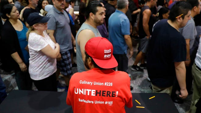 In this May 22, 2018 file photo, Culinary Union members exit a university arena after voting on whether to authorize a strike in Las Vegas. There appears to be a tentative labor agreement that would cover about a quarter of the 50,000 hotel and casino workers that are threatening to strike in Las Vegas.
