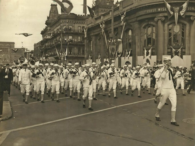 A U.S. Navy band marches along Kilbourn Ave. past the