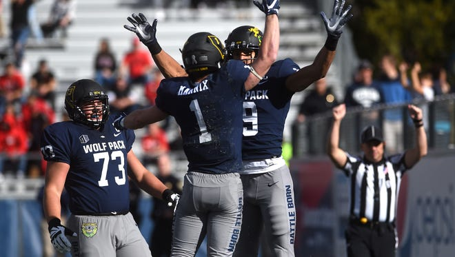Nevada's Wyatt Demps (19) celebrates with teammate McLane Mannix after scoring a touchdown while taking on UNLV during the battle for the Fremont Cannon football game at Mackay Stadium in Reno on Nov. 25, 2017.