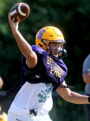 Smyrna's Blake Watkins (21) passes the ball during