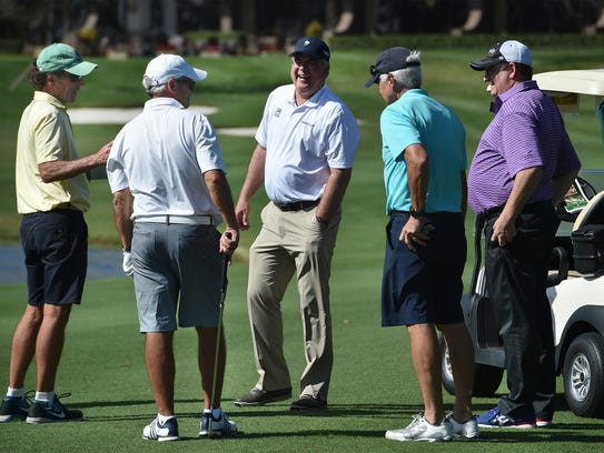 Professional golfer Kenny Perry (center) meets with