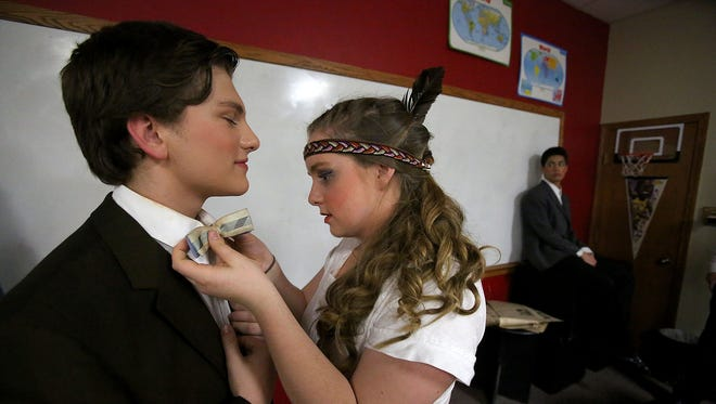 "Cassie Johnson helps Jed Kitterman with his bow tie backstage during Western Mennonite School's production of ""Music Man"" on Thursday, May 21, 2015, in Salem, Ore."