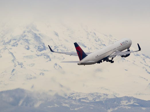 A Delta Air Lines Boeing 767-300 bound for Asia climbs