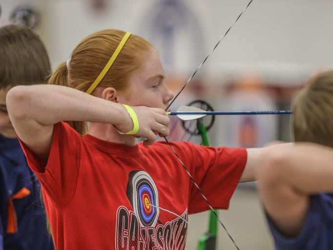 Kelsey Greenwell 11, from South Middle School, in Warrick, aims her arrow.