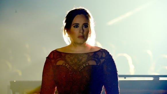 Adele performs onstage during The 58th GRAMMY Awards.