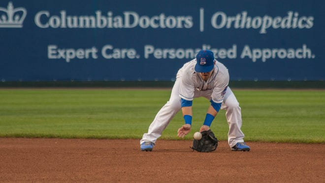 Matt Nandin of the Rockland Boulders fields a ground ball during Game 3 of the Can-Am championship series at Provident Bank Park in Ramapo on Friday night. Nandin drove in the winning run in the Boulders' 5-4 win.