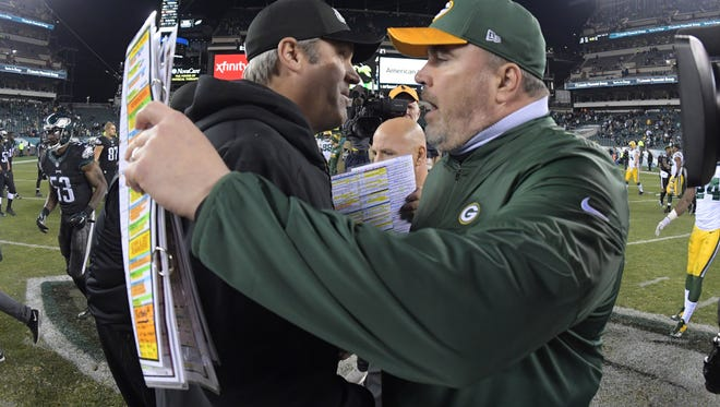 Philadelphia Eagles coach Doug Pederson (left) and Green Bay Packers coach Mike McCarthy embrace after a NFL football game at Lincoln Financial Field.The Packers defeated the Eagles 27-13.