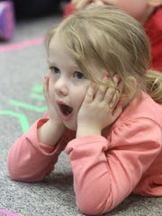 A local child reacts to a Des Moines Metro Opera story time in 2017.