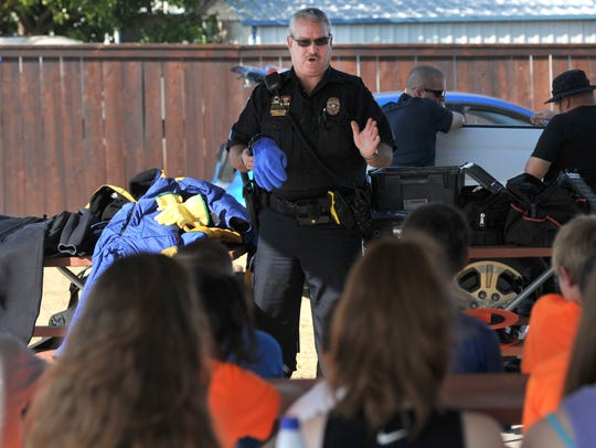 Wichita Falls Police Department dive team member Sgt. Rick Cullar talks to a group of WFPD's Junior Police Academy members about some of the equipment the team uses when they are deployed to a water rescue or recovery.