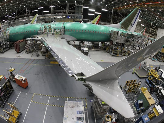 In this photo taken with a fish-eye lens, a Boeing 737 MAX 8 airplane sits on the assembly line during a brief media tour in Boeing's 737 assembly facility, Wednesday, March 27, 2019, in Renton, Wash.
