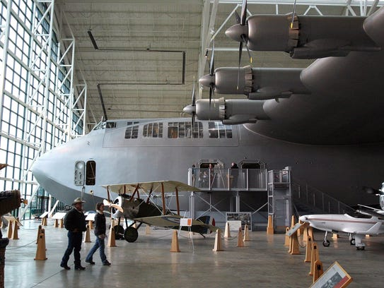 People walk near the Spruce Goose at the Evergreen