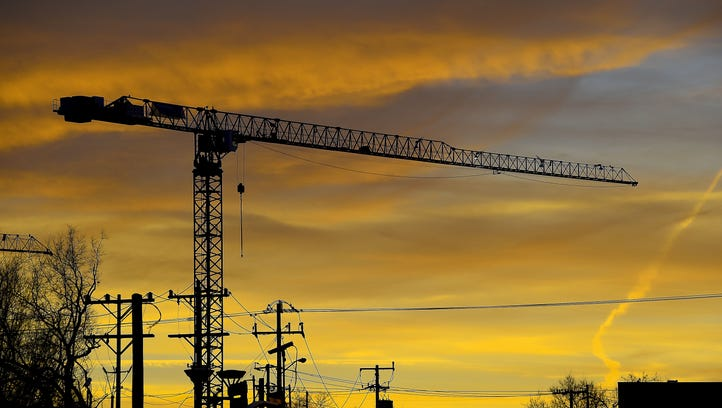 Construction cranes dot the skyline.