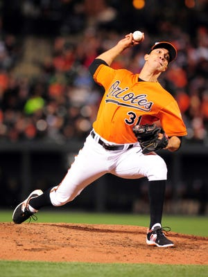 Orioles pitcher Ubaldo Jimenez throws a pitch in the sixth inning against the Toronto Blue Jays at Oriole Park at Camden Yards in Baltimore.