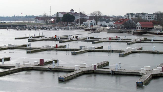 A thin coat of ice forms by the docks of the Marina in this Dec. 2, 2013 file photo.