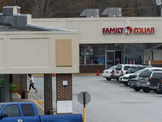 A woman walks to a store at the Lakeside Shopping Center