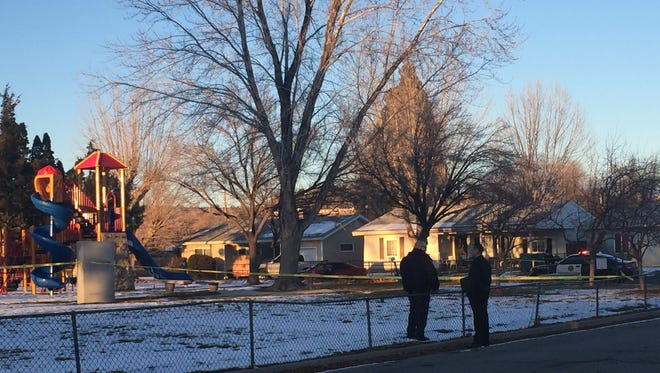 Police block off an area around Pat Baker Park on Tuesday afternoon after a shooting.
