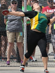 Ashwaubenon's Kris Lindow throws the discus during