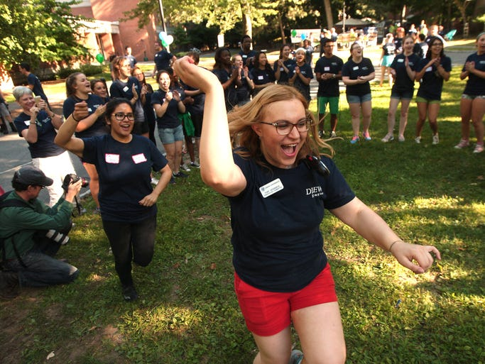 Tori Veninata takes her turn chanting as Drew University students help incoming students moving into their residence halls. August 29, 2014, Madison, NJ. Photo by Bob Karp