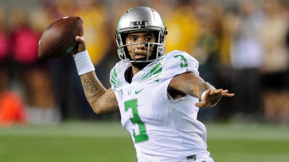 Oct 29, 2015; Tempe, AZ, USA; Oregon Ducks quarterback Vernon Adams Jr. (3) throws during the second half against the Arizona State Sun Devils at Sun Devil Stadium. Mandatory Credit: Matt Kartozian-USA TODAY Sports
