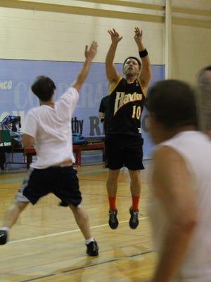 Jim McCormick of Cocoa Beach makes a jump shot during a local basketball league.