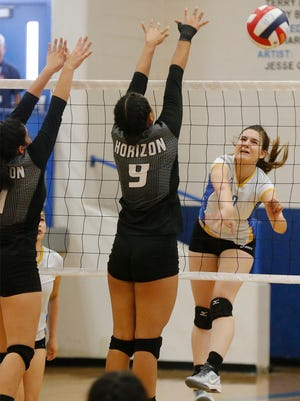 Alivia Ugalde, of Eastwood High School, returns the ball against Judith Loya of Horizon High School on Saturday during the championship game of the 2016 McDonald's Volleyball Classic at Eastwood High School. The Troopers won the championship, defeating the Scorpions in straight sets.