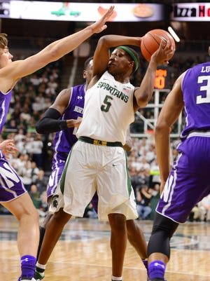 Freshman guard Cassius Winston looks to pass during the game against Northwestern on Friday, Dec. 30, 2016 at Breslin Center. The Spartans won, 58-50.