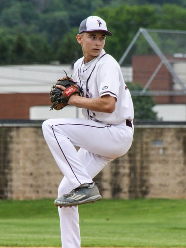 Southern Fulton's Gabe Stotler steps to throw a pitch