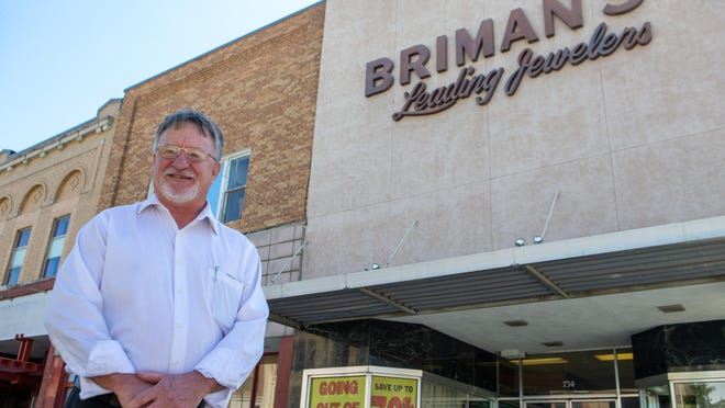 Rob Briman stands Monday morning in front of his store, Briman's Leading Jewelers, 734 S. Kansas Ave. After more than 80 years in business, the store plans to close its doors following a liquidation sale, which begins Tuesday.