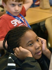 Alyssa Jones, front, and Brendon Riley listen to instructors at a Manufacturing and Coding Academy summer camp at the Strawberry Plains campus of Pellissippi State Thursday, July 14, 2016. Students learned to program robots they built. The students are from Project GRAD, the Boys & Girls Club, Great Schools Partnership and the Emerald Youth Foundation.