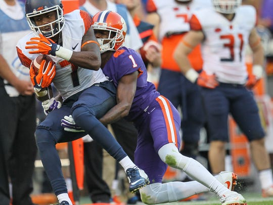 Clemson cornerback Trayvon Mullen (1) tackles Syracuse wide receiver Amba Etta-Tawo (7) in a 2016 game against Syracuse at Memorial Stadium.