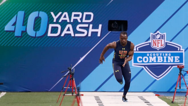 Washington Huskies wide receiver John Ross set a record in the 40-yard dash at the NFL combine in Indianapolis last month, finishing in 4.22 seconds.