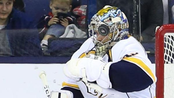 Predators goalie Pekka Rinne (35) makes a save in the third period Friday.
