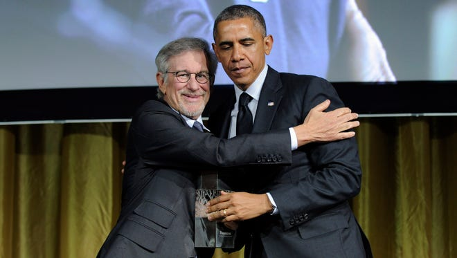 President Barack Obama, right, gets a hug from movie director Steven Spielberg.
