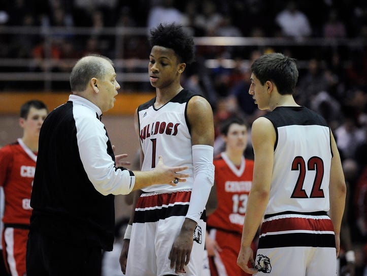 New Albany head coach Jim Shannon (left) talks with