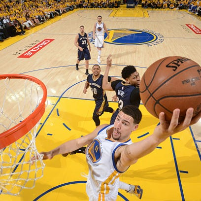 Klay Thompson #11 of the Golden State Warriors goes