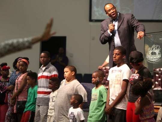 Bishop Bobby Hilton prayed for the children in attendance at a prayer service for the victims of the Charleston shooting Thursday at the Word Family Life Center in Forest Park.