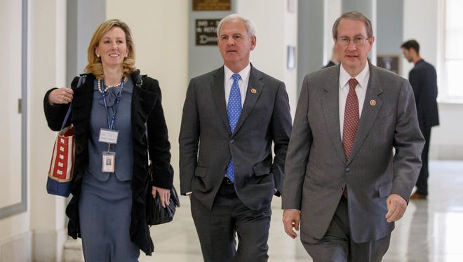 From left, Rep-elect Barbara Comstock, R-Va., Rep. Bradley Byrne, R-Ala., and House Judiciary Committee Chairman Rep. Bob Goodlatte, R-Va., arrive on Capitol Hill in Washington, Thursday, Nov. 13, 2014, as House Republicans prepare to choose their leadership for the 114th Congress that convenes in January.  (AP Photo/J. Scott Applewhite)
