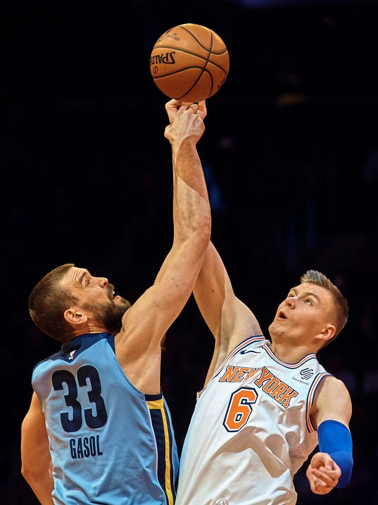 Memphis Grizzlies' Marc Gasol (33) competes for the ball with New York Knicks' Kristaps Porzingis (6) during the first half of an NBA basketball game at Madison Square Garden in New York, Wednesday, Dec. 6, 2017. (AP Photo/Andres Kudacki)