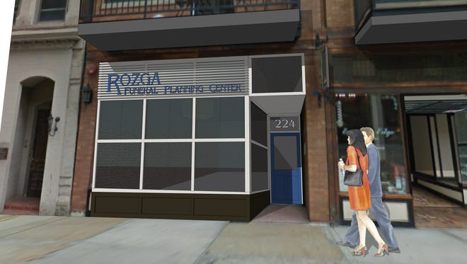 An artist's rendering shows the Rozga Funeral Planning Center set to open in September at 224 E. Mason St.