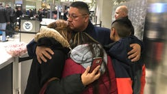 Jorge Garcia, 39, of Lincoln Park, Mich., hugs his